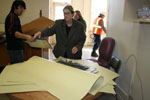 UTEP staff handles oversized photos and blueprints.