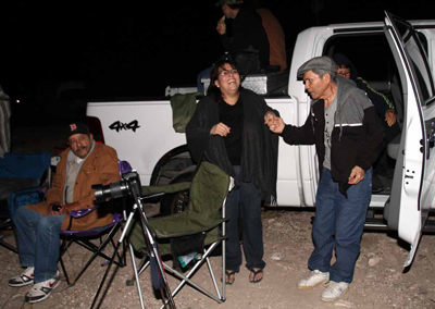 Ramon Paz, right, a 30-year employee of Asarco is helped out of a truck by his daughter, Marisa Jacquez at an overlook point off Executive Center Blvd. Saturday before dawn to watch the former ASARCO stacks go down. (Rudy Gutierrez/El Paso Times)