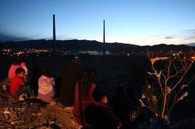 Juarez residents came out early Saturday morning before the Asarco demolition. (Jesus Alcazar / El Paso Times)