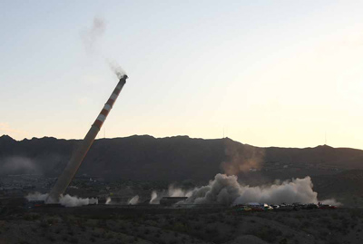 An angle from the Juarez side of the border of the Asarco smokestacks early Saturday morning. (Jesus Alcazar / El Paso Times)
